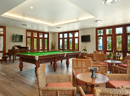 Games room and library at Kempinski Seychelles