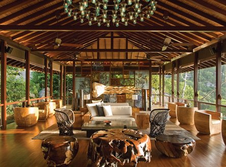 Relaxing lounges in traditional Creole style at Four Seasons Seychelles