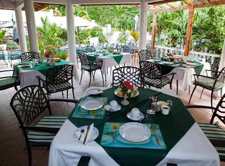 Take breakfast beside the pool at Hanneman Apartments in Seychelles