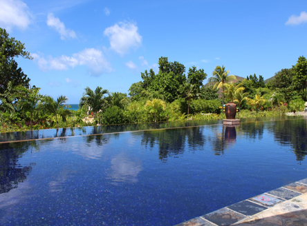 The main swimming pool at Raffles Praslin Seychelles